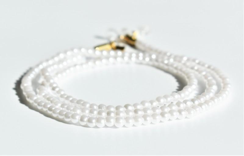 Glasögonsnöre vita pärlor